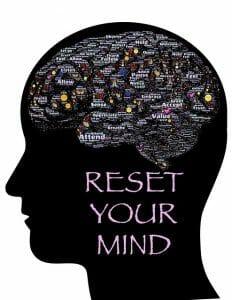 Illustratie van het hoofd, de omtrek van de hersenen en de inscriptie: reset je geest